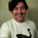 The author, posing in an existential Black Swan T-shirt